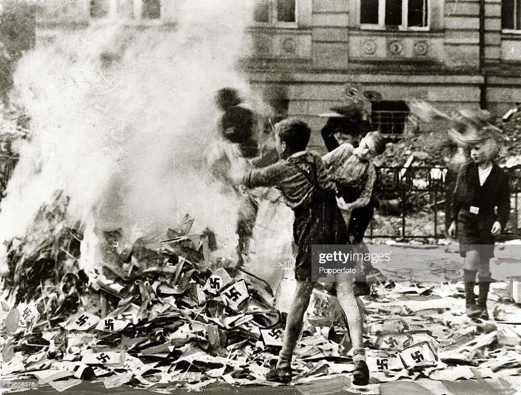 World War II, pic: circa 1945, German boys pictured burning Nazi books and swastikas in Cologne : News Photo