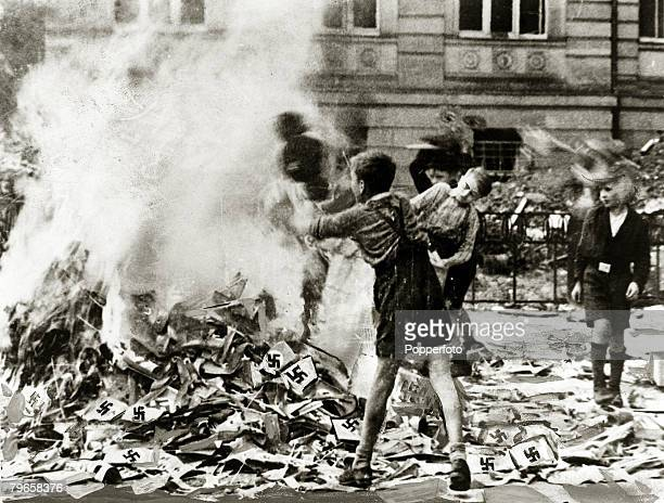 circa 1945 German boys pictured burning Nazi books and swastikas in Cologne
