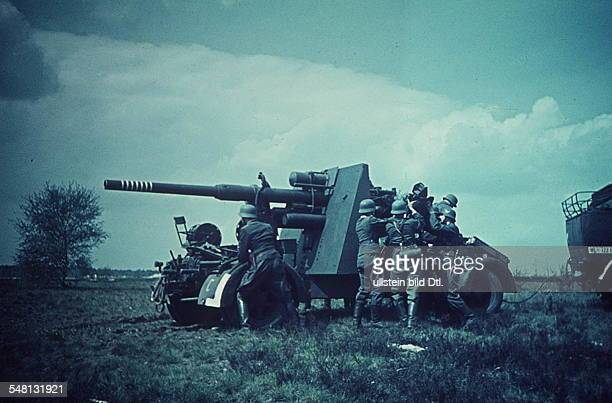 World War II Positioning an 88 cm Flak of the German air force at the Eastern Front summer 1941 Photographer Artur Grimm