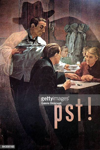 A World War II poster depicts a waiter serving a couple at a cafe whilst a sinister shadow looms over them circa 1943 The word 'Pst' warns against...