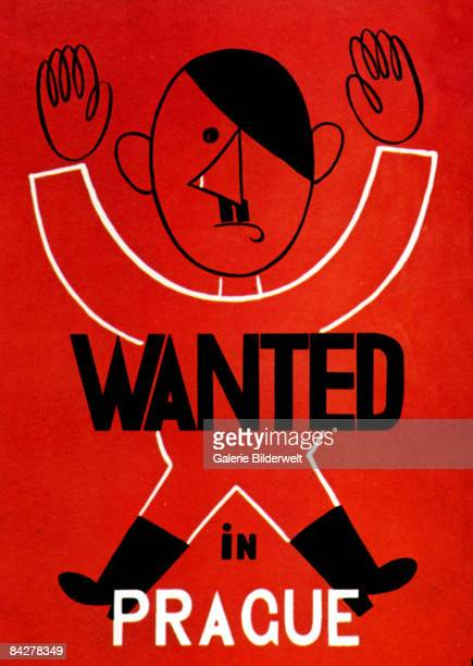 A World War II poster featuring Adolf Hitler with his arms raised and the slogan 'Wanted In Prague' circa 1940 Poster by Adolf Hoffmeister from the...