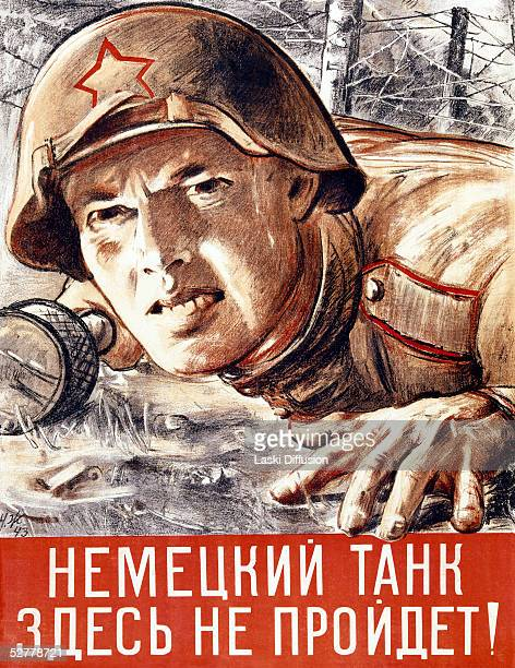 World War II propaganda poster depicting a Russian soldier crawling through barbed wire with a hand grenade 1943 The caption reads 'The German Tank...