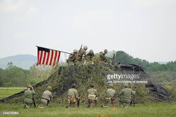 World War II reenactment of US Marines raising the American flag on Iwo Jima on February 23, 1945 at Mid-Atlantic Air Museum World War II Weekend and...