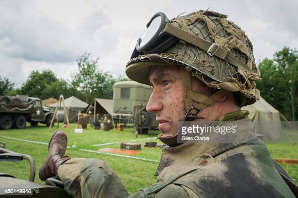 World War II reenactor stands watch at an encampment June 3 2014 in Normandy France The 70th anniversary of DDay attracts groups of individuals who...