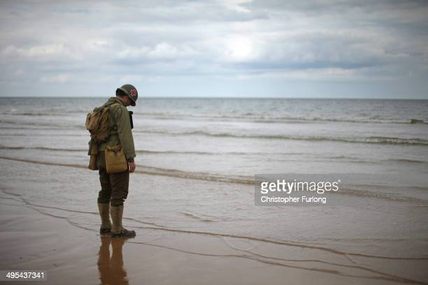 World War II reenactors practice for the 70th anniversary of DDay on Omaha Beach on June 3 2014 in ViervillesurMer France Friday 6th June is the 70th...