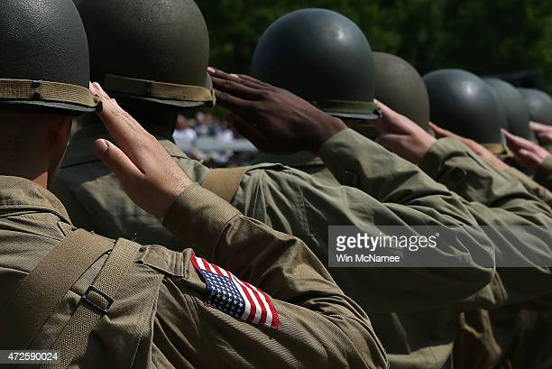 World War II reenactors salute while the American National Anthem plays during ceremony commemorating 70th Anniversary of VE Day at the National...