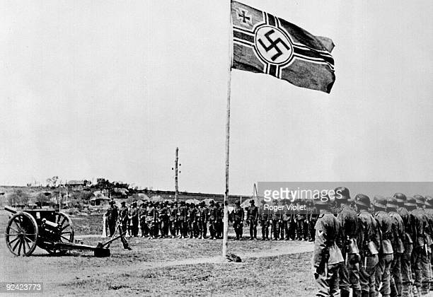 World War II Russian volunteers recruited into a German regiment of artillery taking an oath to the Nazi flag June 1943