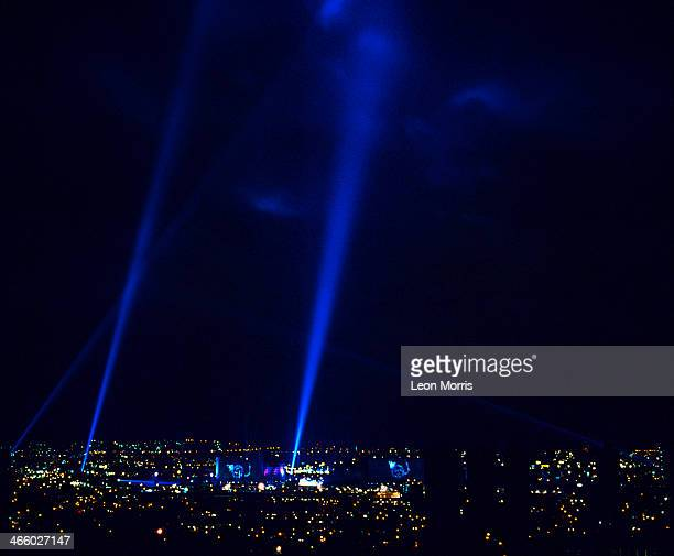 World War II searchlights illuminate the sky at one of the two 'Destination Docklands' outdoor concerts given by French electronic composer Jean...