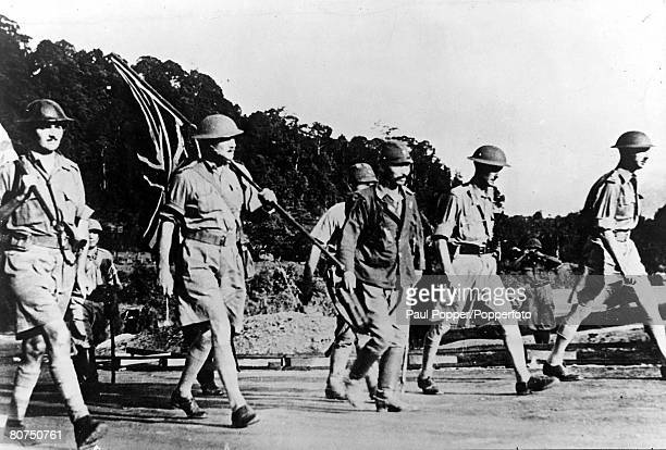 World War II Singapore Far East General Percival who was British Commander at Singapore is pictured on his way to surrender the British stronghold to...