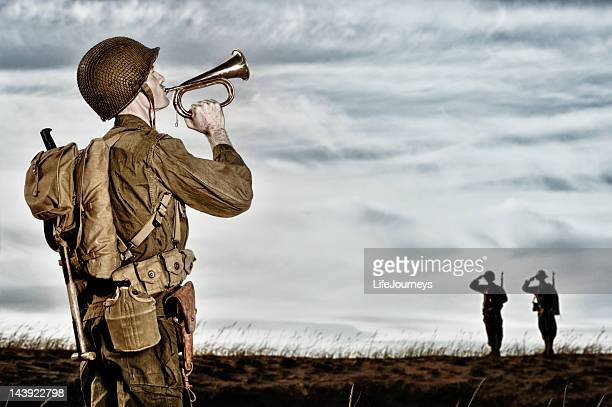 world war ii soldier playing taps - bugle stock pictures, royalty-free photos & images