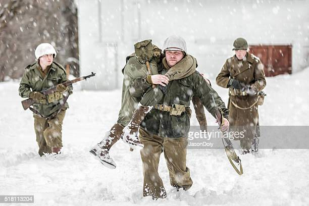 world war ii soldiers carrying wounded - wounded soldier stock photos and pictures