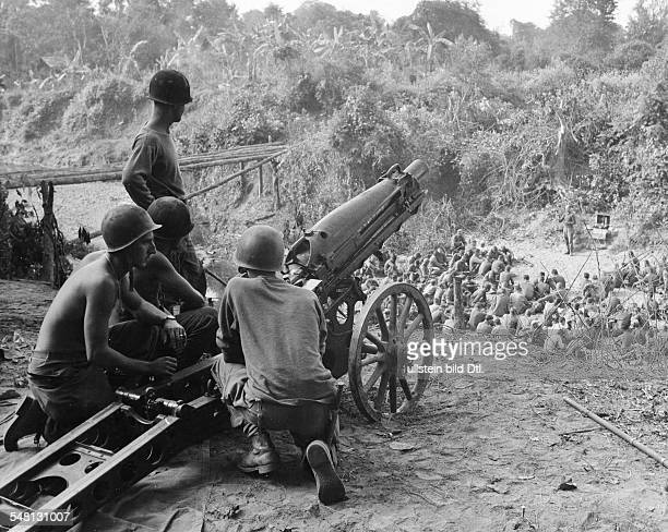 World War II - South East Asia, Burma US soldiers celebrating Christmas in the Burmese jungle. The service is being guarded by a cannon