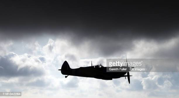 World War II Spitfire flies over Kent, during a formation to drop of three-quarters-of-a-million poppies over the White Cliffs of Dover in a tribute...