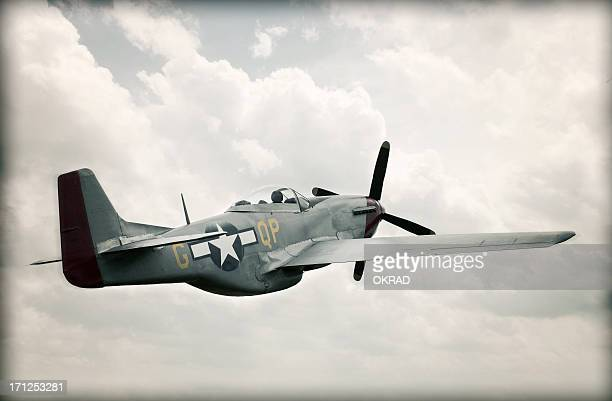 world war ii tf-51 mustang in sky - aged - military airplane stock pictures, royalty-free photos & images