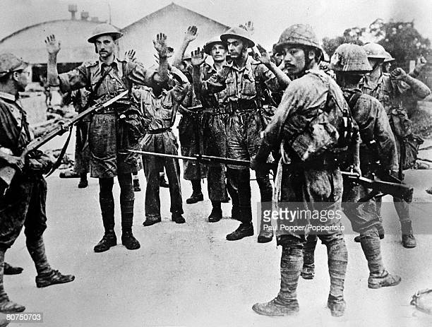World War II The Fall of Singapore 15th February 1942 Some of the 12000O British Australian Indian and Chinese forces captured by the Japanese forces...