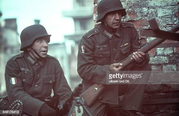 World War II Two soldiers of the 'Legion des volontaires francais' in a conquered town on the Eastern Front late autumn 1941 Photographer Artur Grimm
