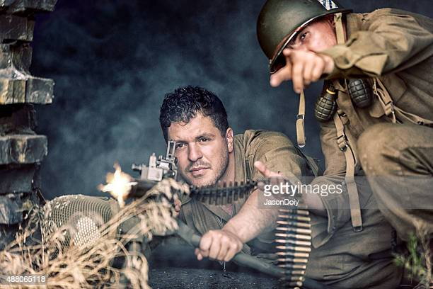 world war ii us army soldier firing a 50 caliber - machine gun stock pictures, royalty-free photos & images
