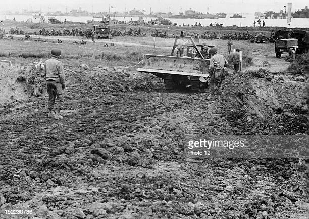 World War II US soldiers building a supply road on a beachhead a few days after DDay June 1944 Normandy France