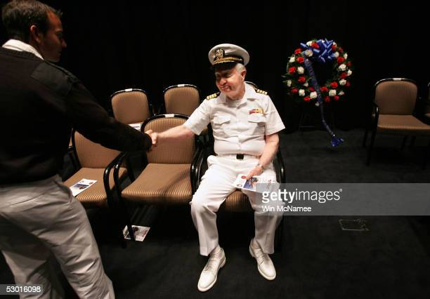 World War II veteran Captain Walter Beckham retired USN accepts a thank you from an attendee of a ceremony marking the 63rd anniversary of the Battle...