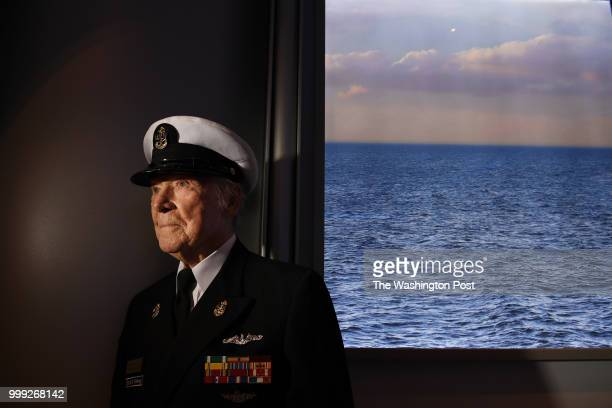 World War II veteran Hank Kudzik poses for a portrait at the Naval Heritage Center following the Sea of White ceremony that remembers the Battle of...