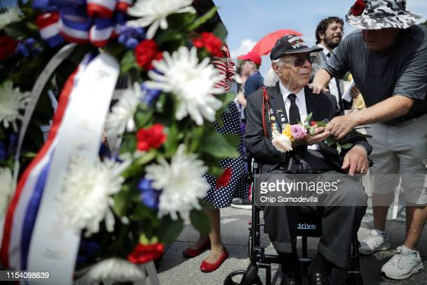 World War II veteran Herman Zeitchik is given a handful of roses during a wreath laying ceremony at the World War II Memorial on the National Mall on...