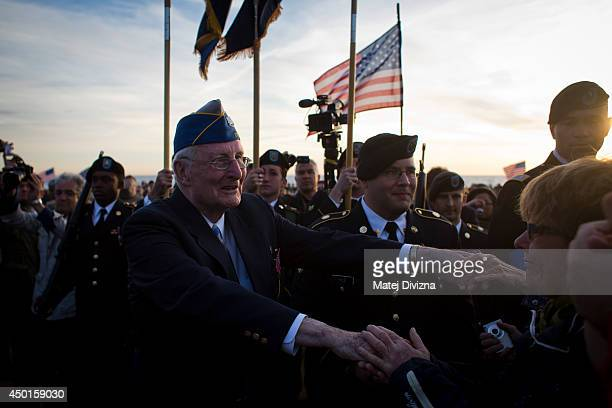 World War II veteran of the US 29th Infantry Division Morley Piper greets people during gathering on the Omaha Beach to commemorate the sacrifices of...