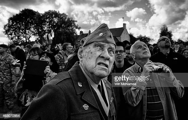 World War II veteran Raymond W Sylvester who was with the 86th Chemical Mortar Battalion while fighting in France watches as paratroop veterans drop...