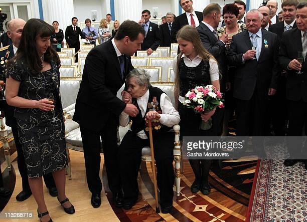 World War II veteran Tatyana Romanova kisses the hands of Russian President Dmitry Medvedev during an awards ceremony at the Kremlin on April 29 2011...
