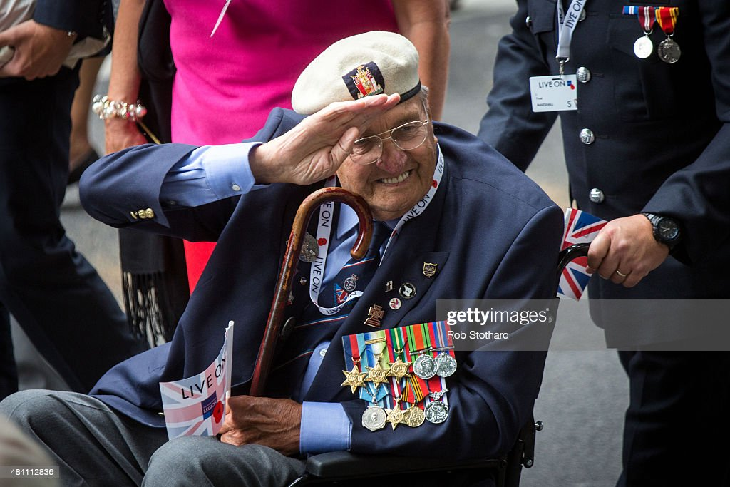 A World War II veteran waves to cheering crowds during a parade down Whitehall at the 70th Anniversary commemorations of VJ Day (Victory over Japan) on August 15, 2015 in London, England. The event marks the 70th anniversary of the surrender of Japanese Forces, bringing about the end of World War II. Queen Elizabeth II and Prince Philip, Duke of Edinburgh will join British Prime Minister David Cameron and former prisoners of war during services throughout the day as tributes are made to the the estimated 71,244 British and Commonwealth casualties of the Far East conflict. Japan formally surrendered on September 2, 1945 at a ceremony in Tokyo Bay on USS Missouri.