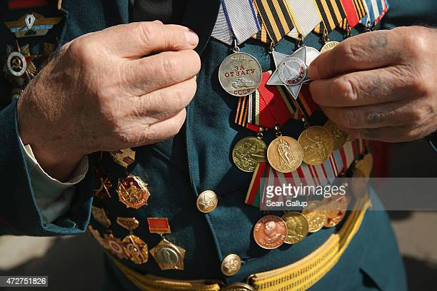 World War II veteran who served in the Soviet Red Army display his medals in Gorky Park during Victory Day celebrations marking the 70th anniversary...