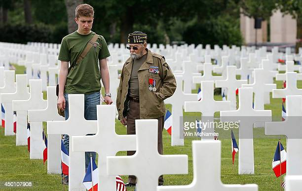 World War II veteran William Spriggs of the 83rd Infantry Division and who took part in the invasion of Normandy visits the grave of his fallen...