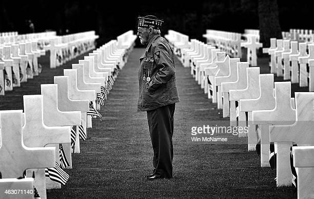 World War II veteran William Spriggs of the 83rd Infantry Division searches for the graves of fallen friends in the Normandy American Cemetery June 5...