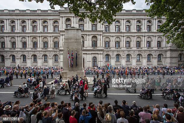 World War II veterans and their families parade past the Cenotaph on Whitehall at the 70th Anniversary commemorations of VJ Day on August 15 2015 in...