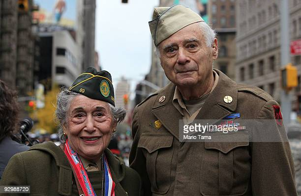 World War II veterans Margie Zwick Women's Army Corps and Arnold Strauch US Army look on before the annual Veterans Day parade November 11 2009 in...