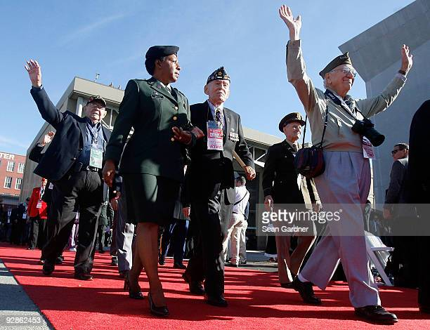 World War II Veterans parade down the red carpet during the National World War II Museum Dedication Ceremony on November 6 2009 in New Orleans...
