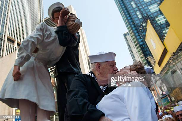 World War II Veterans Ray and Ellie Williams recreate the iconic Alfred Eisenstaedt photograph in Times Square on August 14, 2015 in New York City....