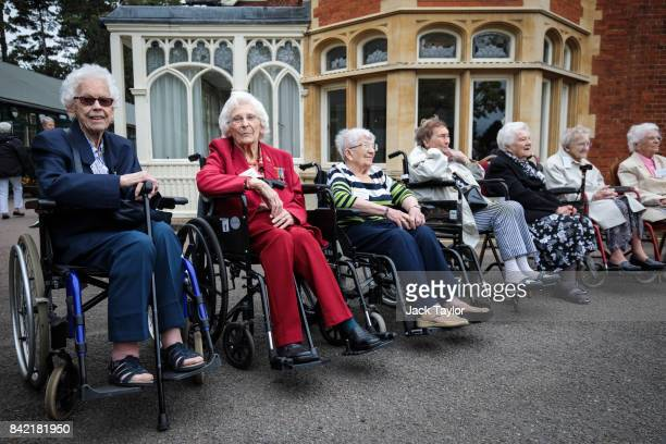 World War II veterans who worked at Bletchley Park and its outstations gather for a group picture in front of Bletchley Park Mansion during an annual...