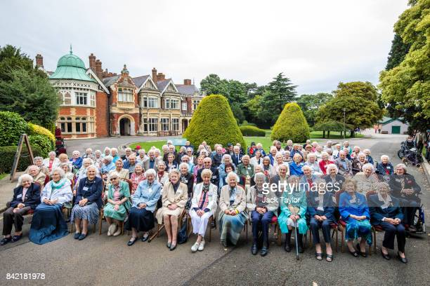 World War II veterans who worked at Bletchley Park and its outstations pose for a picture in front of Bletchley Park Mansion during an annual reunion...