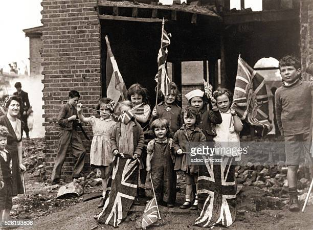 World War II Victory in Europe Day Young children in bomb scarred Battersea in south London with their Union Flags May 8 1945
