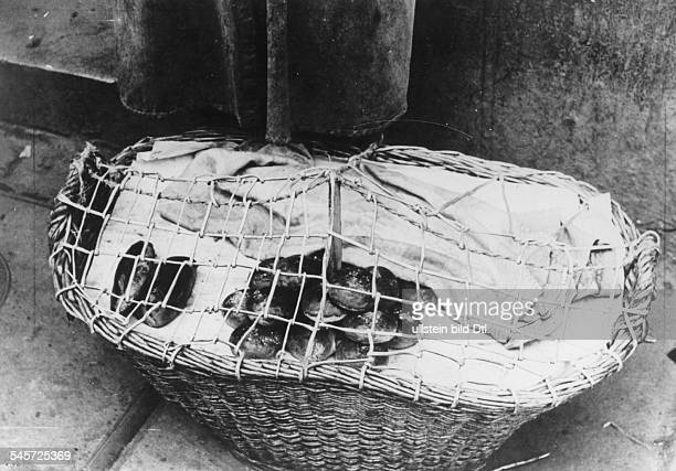 World War II, Warsaw Ghetto during the German occupation: a street hawker has secured her basket with bread loaves against thievery with wire