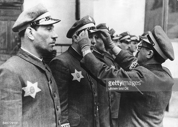 World War II, Warsaw Ghetto during the German occupation: members of the Jewish security service with the Yellow Star on their coats