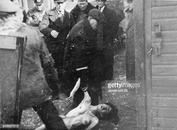 World War II, Warsaw Ghetto during the German occupation: the dead body of a woman is carried off