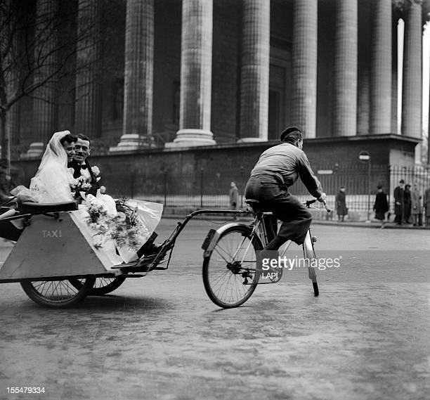 World War II Wedding on a cycle taxi at the place de la Madeleine Paris December 1941