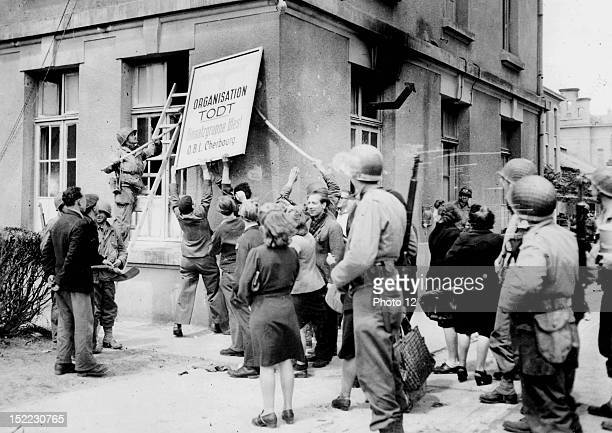 World War II With the help of US soldiers the population of Cherbourg is putting down the insignia of the Todt Organisation just after the town's...