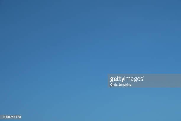 world war ii-era lancaster bomber in flight against clear sky - lancaster bomber stock pictures, royalty-free photos & images