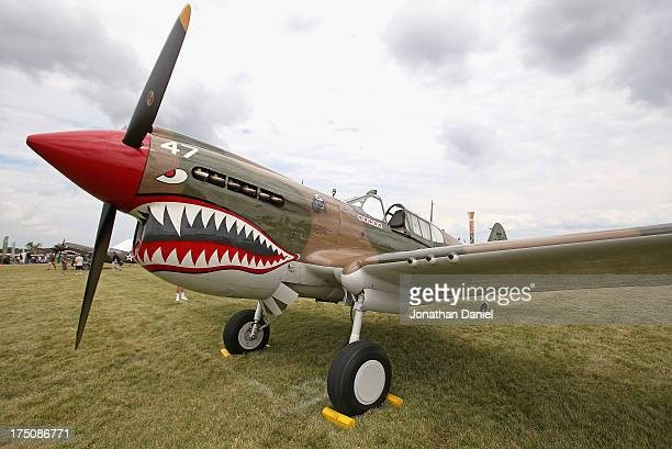 "World War II-era p-40 Warhawk, painted in the colors of the ""Flying Tigers,"" is displayed at the Experimental Aircraft Association AirVenture 2013 at..."