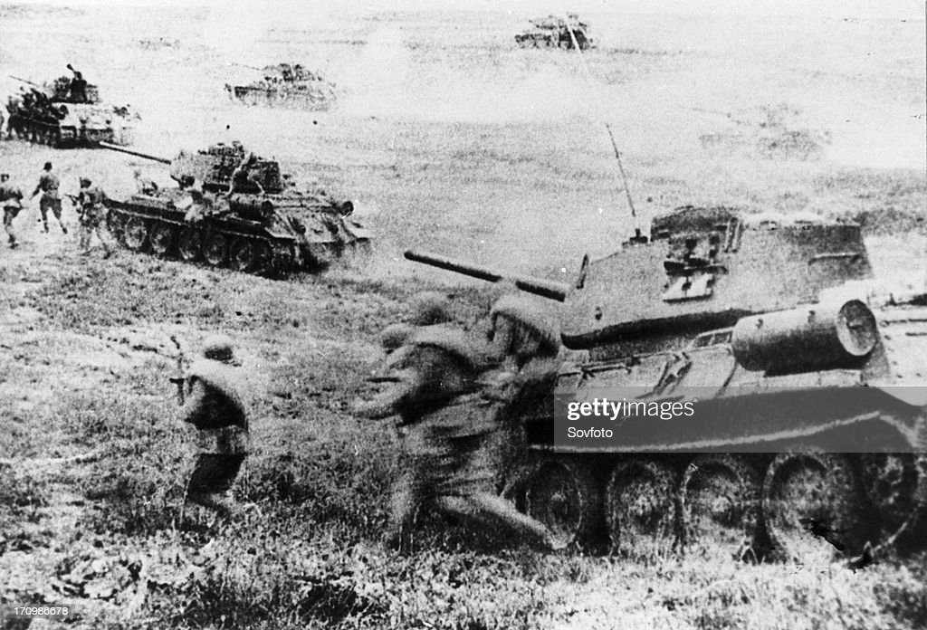 world war ll, red army soldiers and soviet t-34 tanks on the attack during the battle of kursk, july 1943.