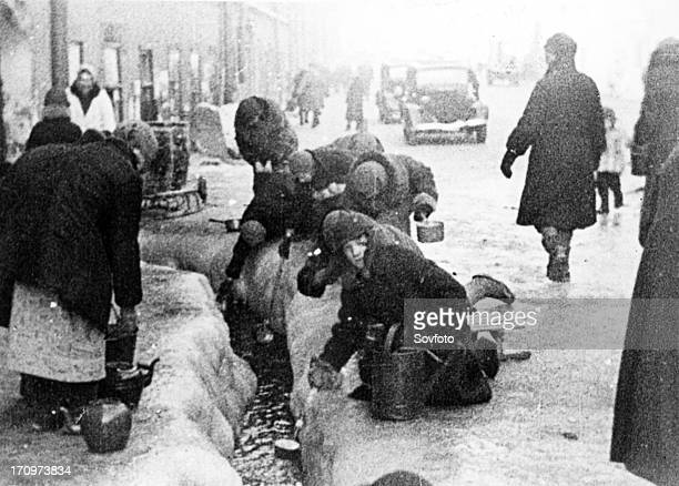 the siege of leningrad women taking water flowing from broken water mains
