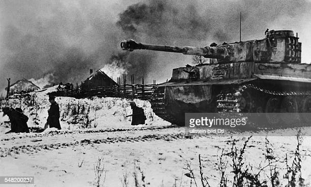 2 World War soviet union theater of war german tank and infantry penetrating into a village January 1944