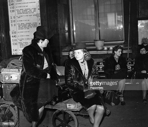 13th May 1940 Mme Brockhuysen Le Zantel with Mlle Claude Phillipe of French nationality who have escaped from Rotterdam resting on their baggage...